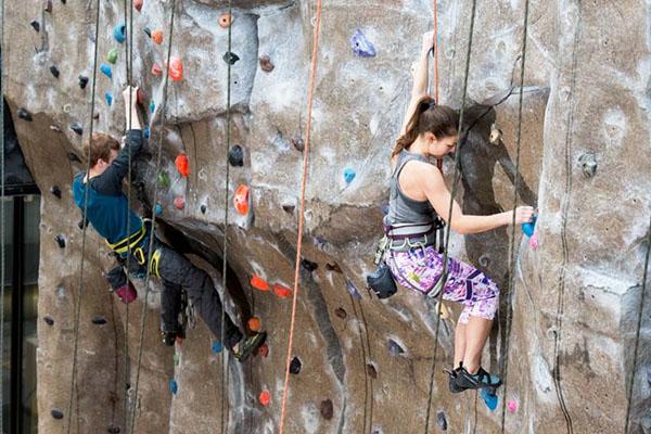 Adults on indoor climbing wall